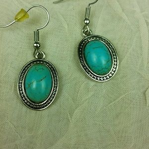 Turquoise colored silver tone earrings